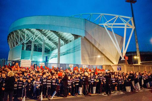The hearse carrying the remains of Anthony Foley paid a stop outside Thomond Park in Limerick tonight, greeted by thousands of grieving fans after arriving into Shannon Airport. Pic. Brian Arthur