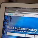 The Airbnb website offers short-term holiday rentals in houses, flats and apartments. Photo Illustration by Justin Sullivan/Getty Images