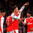 Arsenal's Mesut Ozil celebrates scoring their sixth goal and his hat trick with team mates