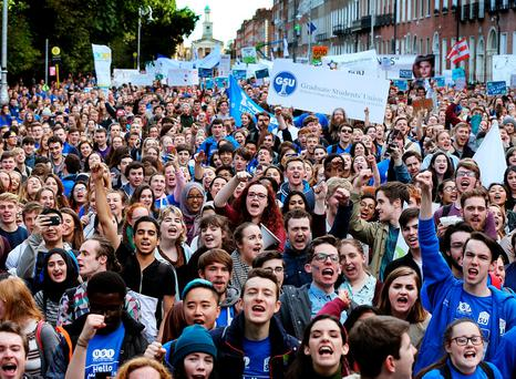 Students marched on Merrion Square, Dublin, yesterday. Photo: Steve Humphreys