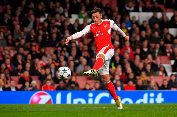 Ozil scores the sixth goal and to complete his hat trick Photo: Reuters / Toby Melville
