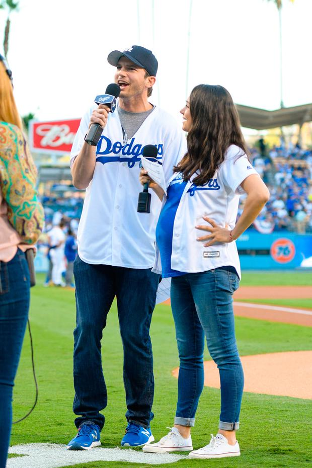 Ashton Kutcher (L) and Mila Kunis attend game 4 of the NLCS between the Chicago Cubs and the Los Angeles Dodgers at Dodger Stadium on October 19, 2016 in Los Angeles, California. (Photo by Noel Vasquez/GC Images)