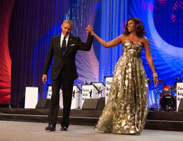US President Barack Obama and First Lady Michelle Obama arrive on stage during the Congressional Black Caucus Foundation's Phoenix Awards Dinner on September 17, 2016