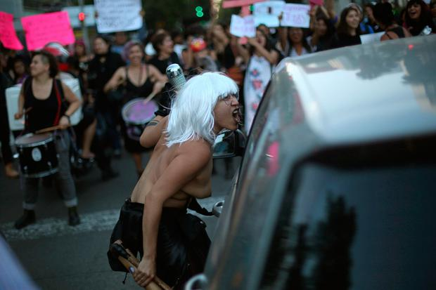 An activist screams at a driver as activists block traffic in a march to protest violence against women and the murder of a 16-year-old girl in a coastal town of Argentina last week, at Reforma avenue, in Mexico City, Mexico, October 19, 2016. REUTERS/Edgard Garrido TEMPLATE OUT