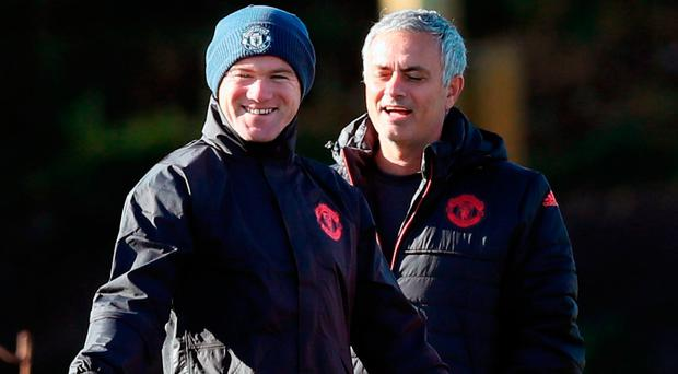 Manchester United's Wayne Rooney and manager Jose Mourinho in training