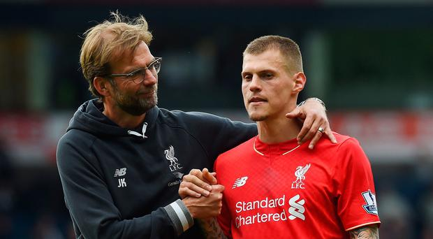 Jurgen Klopp manager of Liverpool with Martin Skrtel after the West Brom game last season