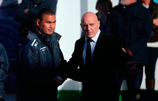 Munsters Keith Wood (right) welcomes Connacht Rugby head coach Pat Lam as the coffin of Munster Rugby head coach Anthony Foley is brought to repose in St. Flannan's Church, Killaloe