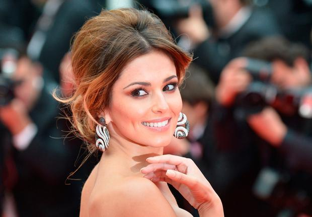 British singer Cheryl Cole poses as she arrives for the screening of the film