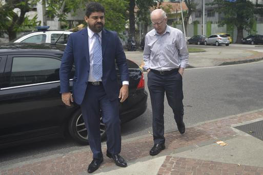 Former OCI president Patrick Hickey remained silent as he arrived at a court in Rio de Janeiro on Thursday to register as part of his bail conditions.