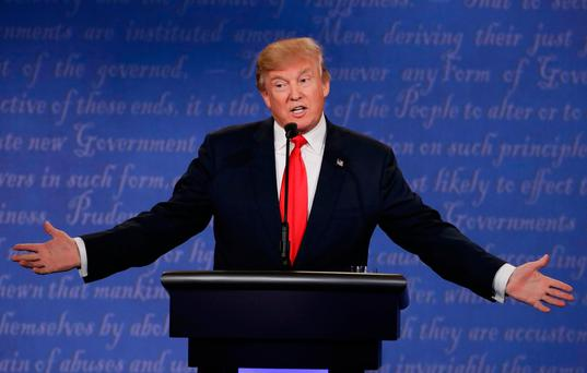 Republican presidential nominee Donald Trump speaks during the third presidential debate with Democratic presidential nominee Hillary Clinton
