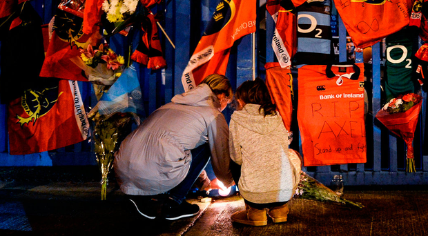 Fans pay tribute to Anthony Foley at the gates of Thomond Park this week. Photo by Diarmuid Greene/Sportsfile