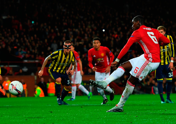Paul Pogba scores the opening goal from the penalty spot