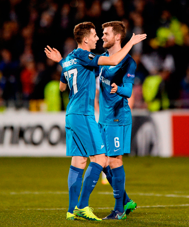 Luka Djordjević, left, and Nicolas Lombaerts congratulate each other following their side's victory. Photo by Seb Daly/Sportsfile