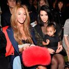 Before the beef - (L-R) Beyonce, Kim Kardashian, and daughter North attend the adidas Originals x Kanye West YEEZY SEASON 1 fashion show during New York Fashion Week Fall 2015 at Skylight Clarkson Sq on February 12, 2015 in New York City. (Photo by Kevin Mazur/Getty Images for adidas)