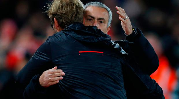 Liverpool manager Juergen Klopp and Manchester United manager Jose Mourinho before the match