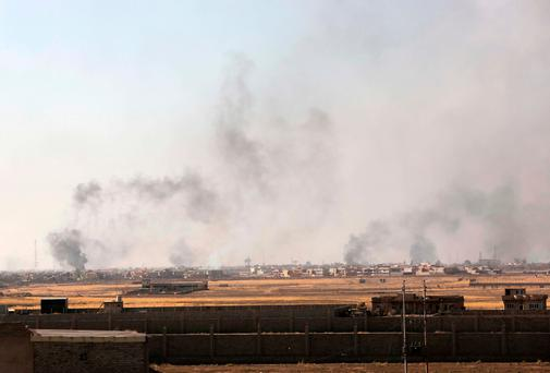 Smoke rises in nearby Mosul as Iraq's elite counterterrorism forces advance towards the city, Iraq (AP Photo/Khalid Mohammed)
