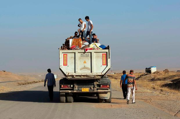 Iraqi displaced people, whose villages was liberated recently, return with their furniture, outside Mosul, Iraq (AP Photo/ Khalid Mohammed)