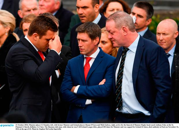Munster player CJ Stander, left, with former Munster and Ireland players Ronan O'Gara and Mick Galwey, right, arrive for the funeral of Munster Rugby head coach Anthony Foley at the St. Flannan's Church, Killaloe, Co Clare. Photo by Stephen McCarthy/Sportsfile