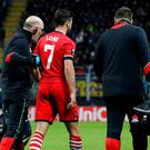 Southampton's Shane Long goes off injured at the San Siro last night
