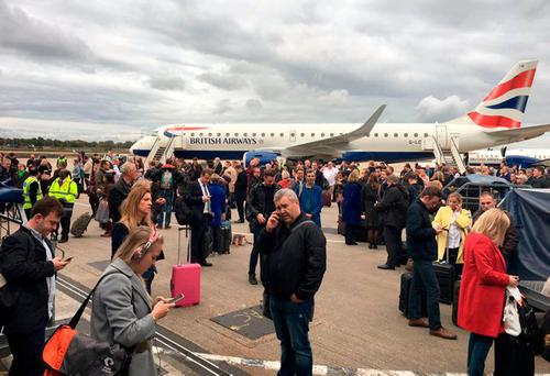 Handout photo taken with permission from the Twitter feed of Chris Daly/@Guru_Chris of passengers outside the terminal building and grounded flights at London City Airport following a fire alert. Photo: Chris Daly/@Guru_Chris/Twitter/PA Wire