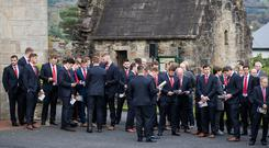 Munster players arrive for the funeral of Munster Rugby head coach Anthony Foley in Killaloe yesterday. Photo: INPHO