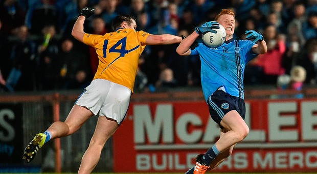 Nathan Donnelly of Killyclogher in action against Peter Donnelly of Coalisland. Photo: Paul Mohan/Sportsfile