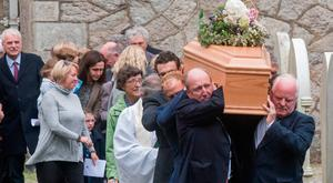 Transport Minister Shane Ross helps to carry the coffin of his mother Ruth Isabel Ross at her funeral at St Patrick's Church in Enniskerry, Co Wicklow, yesterday Photo: Doug O'Connor