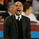 Guardiola: Defiant about system. Photo: John Sibley/Reuters