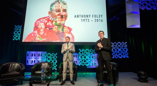 John Kavanagh, MMA coach of Conor McGreggor joins a one minute tribute to Munster Caoch anthony Foley after an interview with Richard Barrett at the One Zero Tech Conference in the RDS. Photo : Tony Gavin 21/10/2016