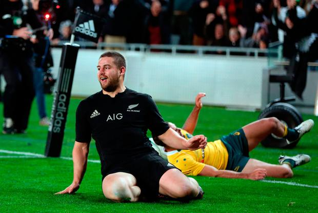 New Zealand's Dane Coles slides in for a try during the third