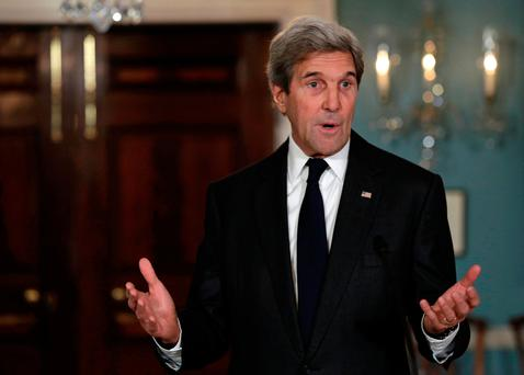 U.S. Secretary of State John Kerry talks to reporters at the State Department in Washington