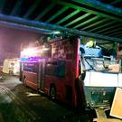 The scene after a private double-decker party bus collided with a bridge on St Loys Road in Tottenham, north London.