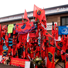 A general view of Munster Rugby, Leinster Rugby and Connacht Rugby flags, scarves and flowers placed outside the Shannon RFC Club house in memory of the late Munster Rugby head coach Anthony Foley