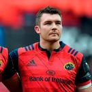 Munster's Simon Zebo, left, sheds a tear as he stands alongside captain Peter O'Mahony during a minute's silence in memory of the late Munster Rugby head coach Anthony Foley before the European Rugby Champions Cup Pool 1 Round 2 match between Munster and Glasgow Warriors at Thomond Park in Limerick.