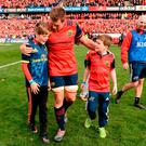 The sons of the late Munster Rugby head coach Anthony Foley, Tony, left, and Dan, join CJ Stander, and the rest of the squad on the field to sing 'Stand Up and Fight' after the European Rugby Champions Cup Pool 1 Round 2 match between Munster and Glasgow Warriors at Thomond Park in Limerick. Photo by Seb Daly/Sportsfile