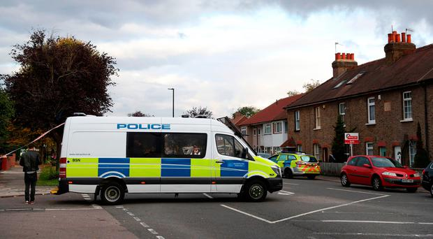 Police at the scene in Wood End Lane, Northolt, London as police are in a stand-off with a man after receiving reports that he is in possession of dangerous items. Andrew Matthews/PA Wire