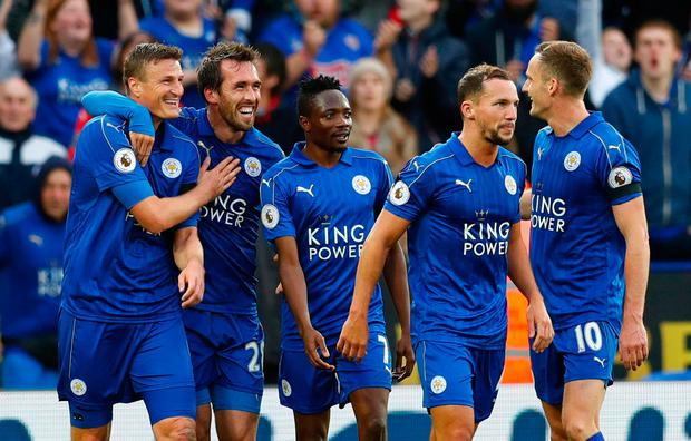Leicester City's Christian Fuchs celebrates scoring their third goal with teammates