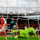 Alex Oxlade-Chamberlain of Arsenal socres a goal but it is disallowed during the Premier League match between Arsenal and Middlesbrough