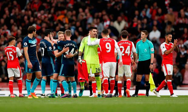 Arsenal's Lucas Perez and Middlesbrough's Victor Valdes after the game