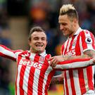 Stoke City's Xherdan Shaqiri celebrates scoring their second goal with Marko Arnautovic