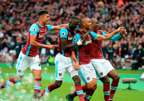 West Ham United's Winston Reid (second right) celebrates