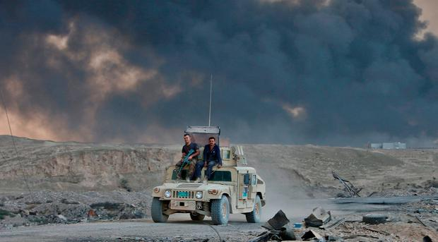 An Iraqi army vehicle is seen during an operation to attack Islamic State militants in Mosul, in Qayyara, Iraq, October 22, 2016. REUTERS/Alaa Al-Marjani