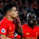 Liverpool's Philippe Coutinho celebrates scoring their second goal with Sadio Mane