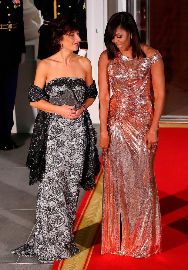 US First Lady Michelle Obama welcomes Agnese Landini, wife of Italian Prime Minister Matteo Renzi, at the Obamas' final state dinner at the White House on Tuesday. Ms Obama has been praised for her style during her time as First Lady Photo: Mark Wilson/Getty