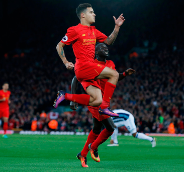 Philippe Coutinho celebrates scoring Liverpool's second goal with Sadio Mane. Photo: Reuters