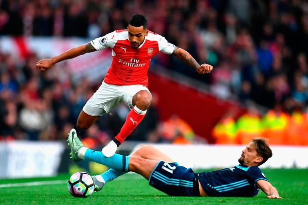 Theo Walcott and Gaston Ramirez compete for the ball. Photo: Getty