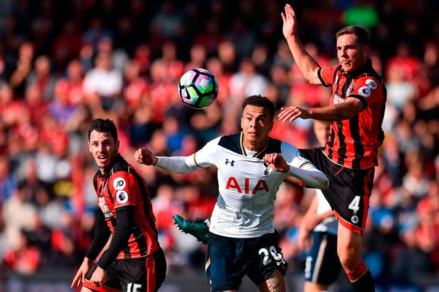 Spur's Dele Alli vies with Bournemouth's Adam Smith (L) and Dan Gosling (R) for a high ball. Photo: Getty