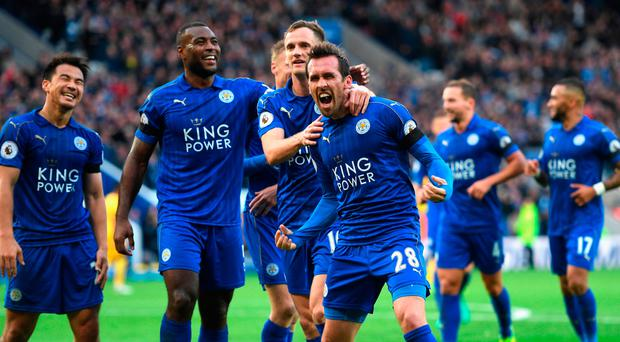 Christian Fuchs of Leicester City (C) celebrates scoring his sides third goal with his Leicester City team mates. Photo: Getty