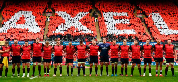 The Munster team during a minute's silence in memory of the late Munster Rugby coach Anthony Foley