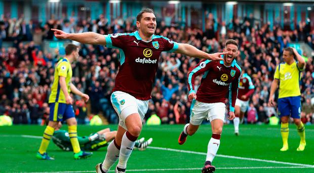 Sam Vokes of Burnley (C) celebrates scoring his sides first goal. Photo: Getty